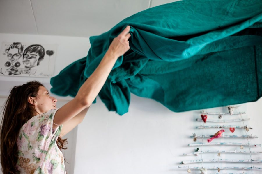 A Kiwi Clean Home residential cleaner making a bed in a Auckland home