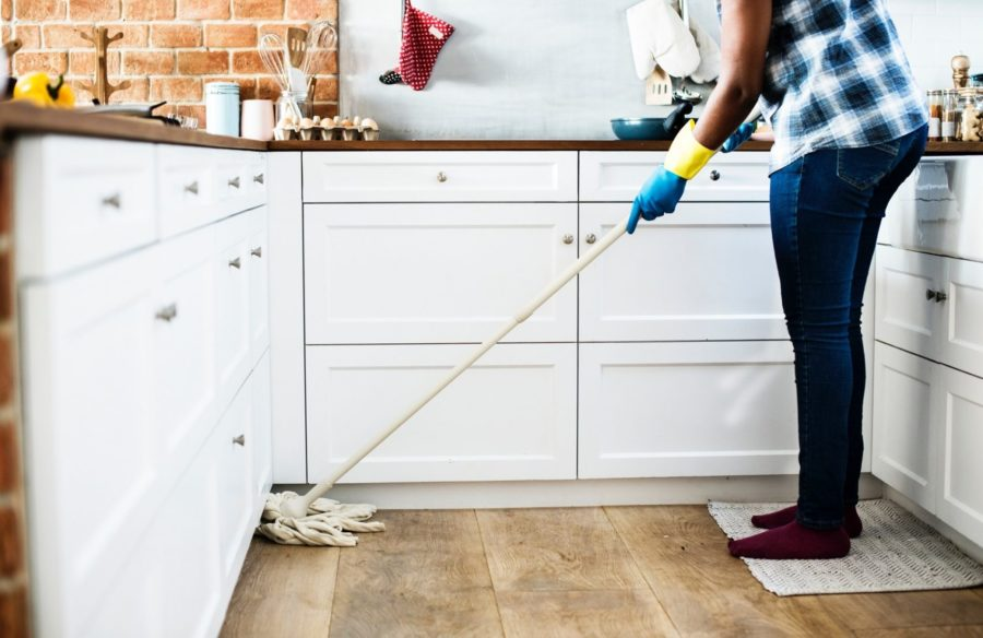A Kiwi Clean Home residential cleaner mopping a floor in a Auckland home