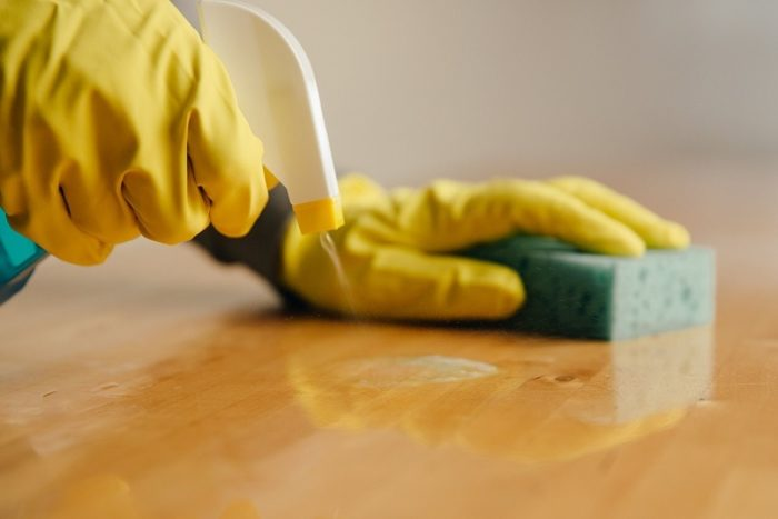 A Kiwi Clean Home residential cleaner in Auckland cleaning a floor